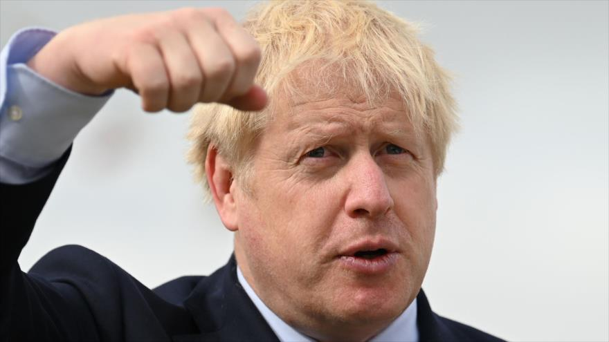El primer ministro del Reino Unido, Boris Johnson, conmemora la semana internacional de Transporte en Londres, 12 de septiembre (Foto: AFP)