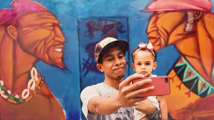 Una foto exhibida en la exposición Nuestro Oficio sobre la realidad del pueblo venezolano ante las sanciones de EE.UU., 24 de septiembre de 2019.