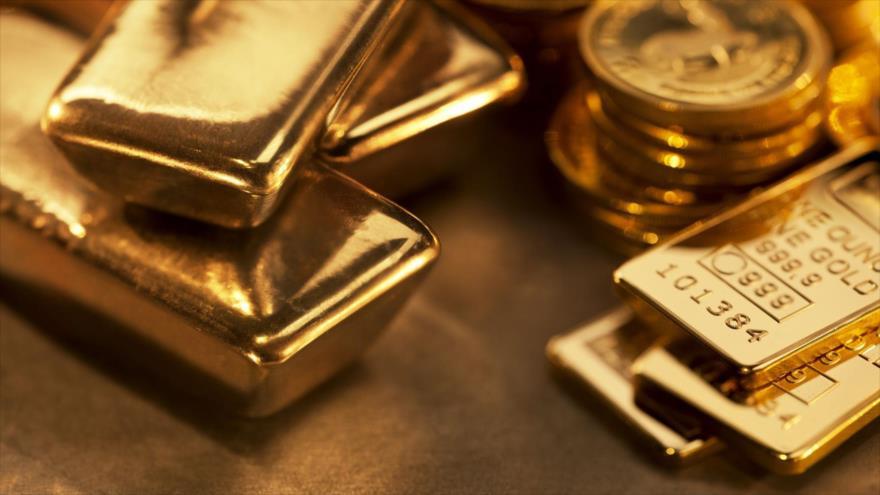 Lingotes y monedas de oro.