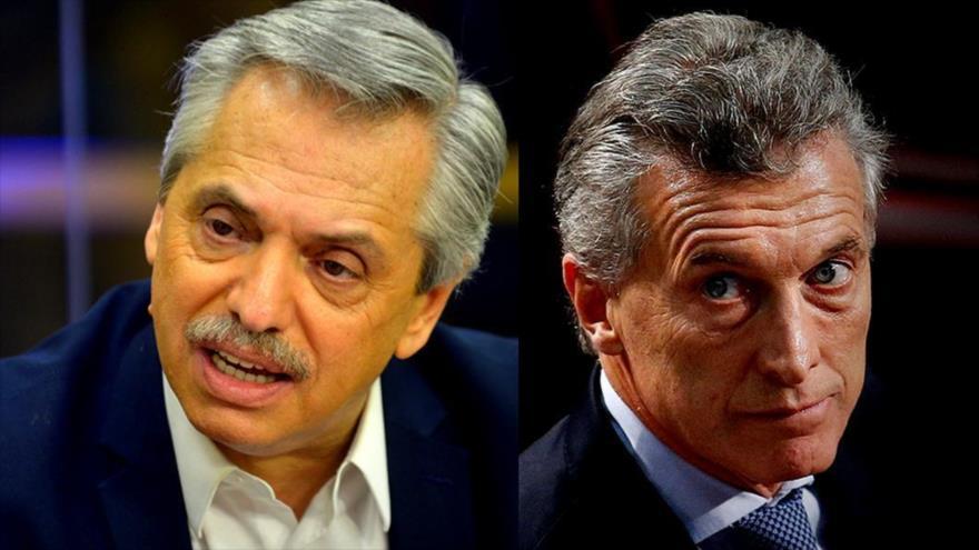 El aspirante de la oposición a presidenciales de Argentina Alberto Fernández (izda.) y el presidente del país, Mauricio Macri.