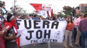 Ciudadanos hondureños señalan a su presidente de narcotraficante