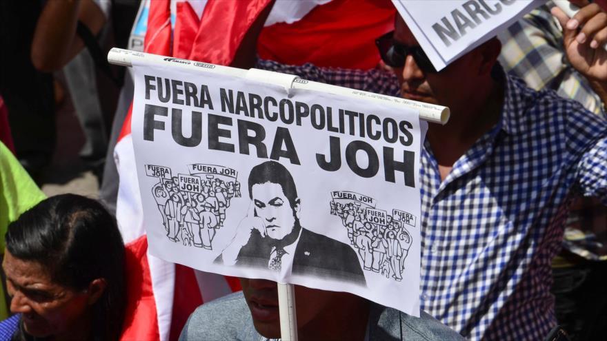 Hondureños piden la renuncia del presidente de Honduras, Juan Orlando Hernández, Tegucigalpa, 16 de octubre de 2019. (Foto: AFP)