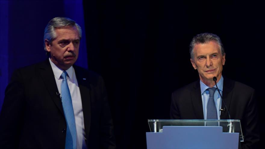 El presidente de Argentina, Mauricio Macri (dcha.), y el candidato presidencial Alberto Fernández, 13 de octubre de 2019. (Foto: AFP)