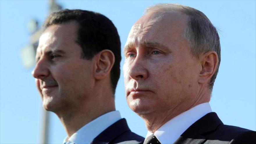 El presidente ruso, Vladimir Putin, (dcha.), y el presidente sirio, Bashar al-Assad, en Siria. 11 de diciembre de 2017.