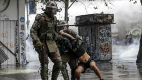 Piñera admite abusos policiales pero defiende militarización