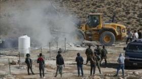 Fuerzas israelíes demuelen casas palestinas en ocupada Cisjordania