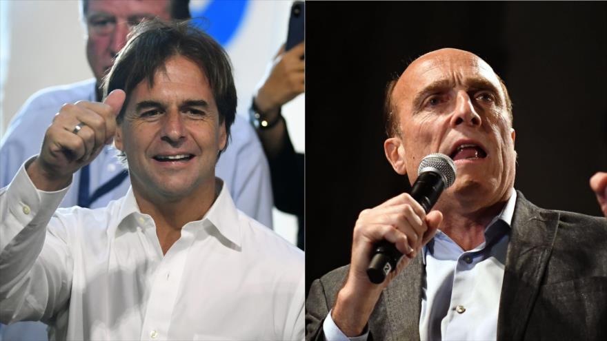 Luis Lacalle Pou, del Partido Nacional (PN), y Daniel Martínez, del Frente Amplio (FA) (dcha.), candidatos del balotaje en Uruguay, 24 de noviembre de 2019.