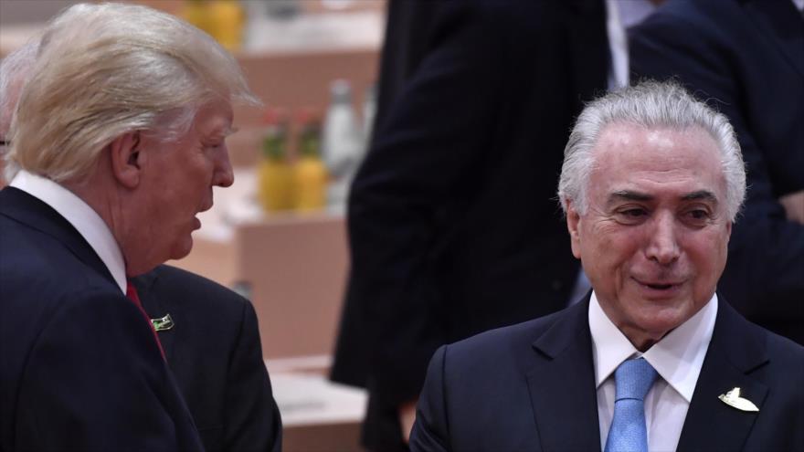 El presidente de EE.UU., Donald Trump (izq.), y el expresidente de Brasil Michel Temer en Hamburgo, Alemania, 8 de julio de 2017. (Foto: AFP)