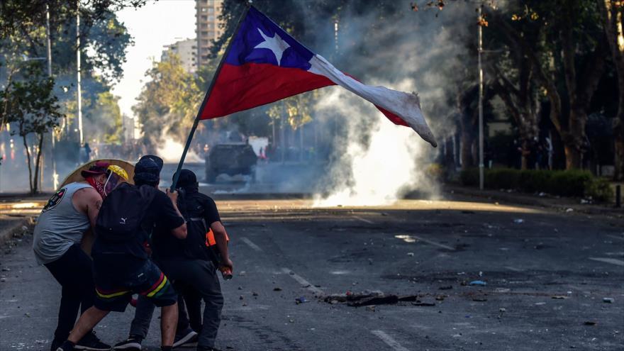 Manifestantes chilenos protestan contra el Gobierno de Sebastián Piñera, Santiago, la capital, 29 de noviembre de 2019. (Foto: AFP)