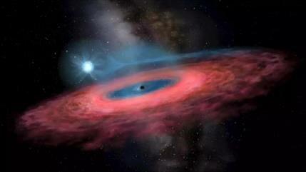 Astrónomos hallan el agujero negro más grande y cercano a Tierra