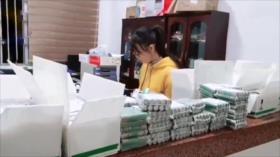 Vídeo: Una mujer china paga una multa con 140 kilos de monedas