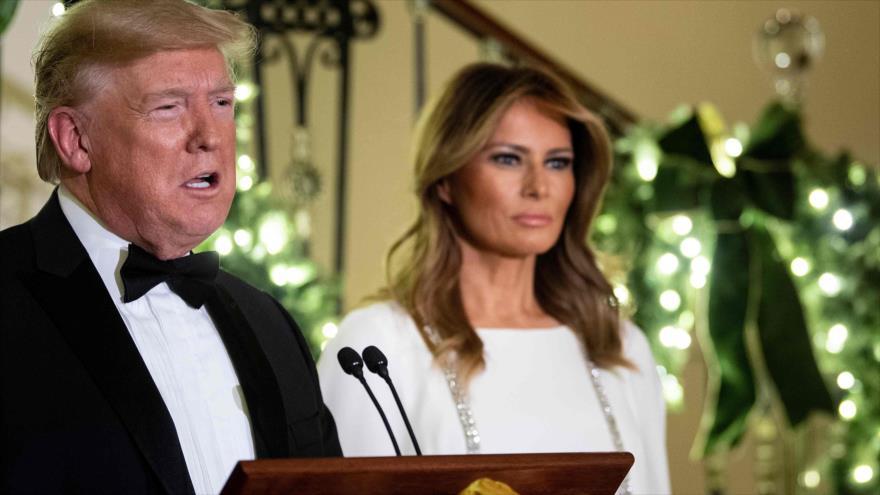 El presidente de EE.UU., Donald Trump, y su esposa Melania, en una ceremonia social en la Casa Blanca, 12 de diciembre de 2019. (Foto: AFP)
