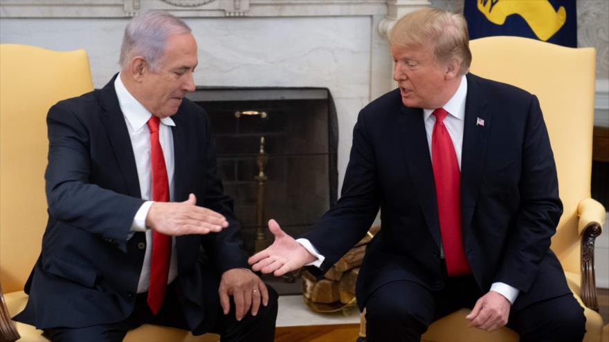 El presidente de EE.UU., Donald Trump (dcha.), y el primer ministro israelí, Benjamín Netanyahu, Washington, 25 de marzo de 2019. (Foto: AFP)