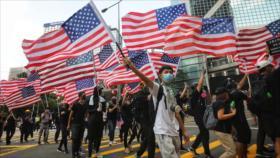 China: Oenegés de EEUU alientan disturbios violentos en Hong Kong