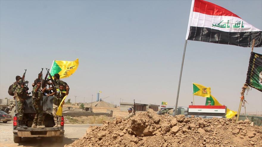 Fuerzas del Movimiento de Resistencia Islámica de Irak, conocido como Kataeb Hezbolá, en un enfrentamiento con los terroristas.