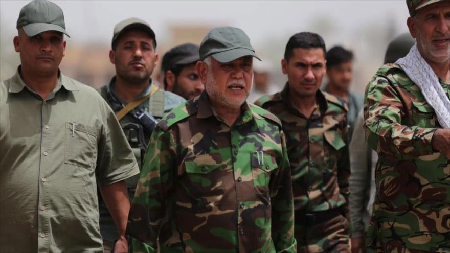 El secretario general de la organización iraquí Badr, Hadi al-Ameri (centro).