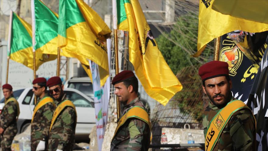 Fuerzas populares piden a tropas iraquíes alejarse de bases de EEUU   HISPANTV