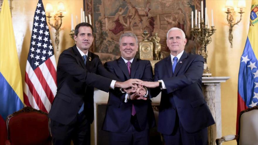 El opositor venezolano Juan Guaidó (izq.), el presidente colombiano, Iván Duque, y el vicepresidente de EE.UU., Mike Pence, en Bogotá, 25 de febrero de 2019.