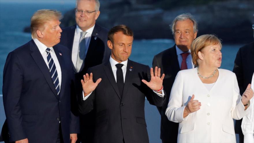 Presidente de EE.UU., Donald Trump, su par francés, Emmanuel Macron, y la canciller alemana, Angela Merkel, Biarritz, Francia, 24 de agosto de 2019.