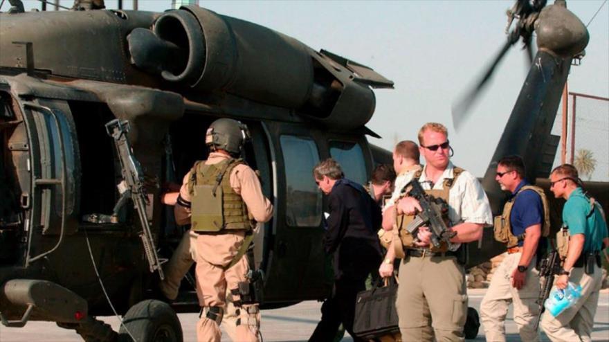 """Varios miembros de una empresa privada de seguridad de EE.UU. en medio de una """"operación"""" de vigilancia en Irak."""