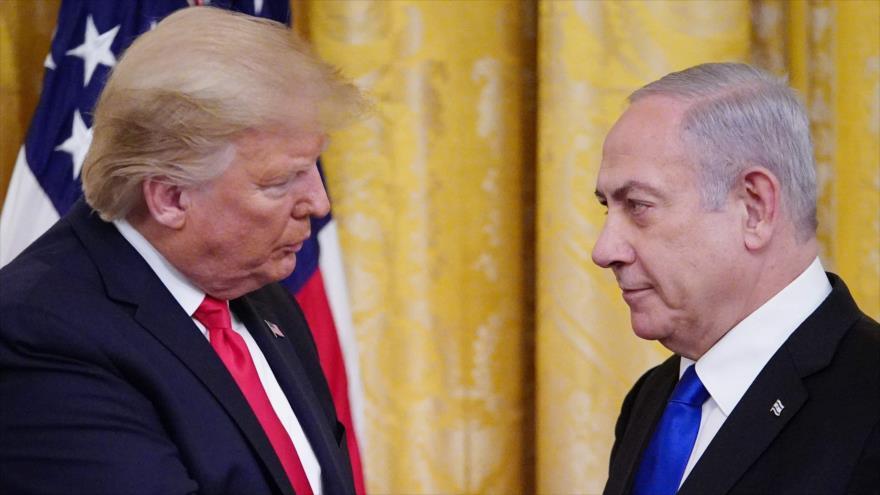 El primer ministro israelí, Benjamín Netanyahu (dcha.) y el presidente de EE.UU., Donald Trump, en la Casa Blanca, 28 de enero de 2020. (Foto: AFP)
