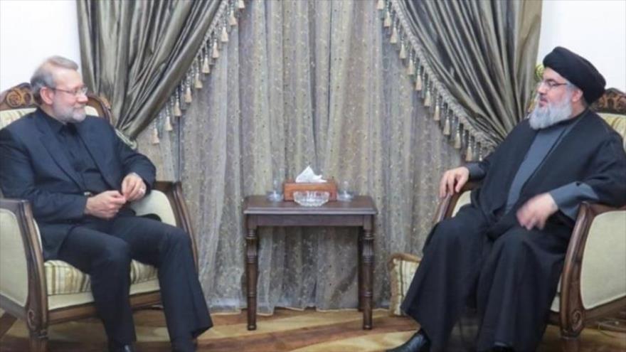 El presidente del Parlamento de Irán, Ali Lariyani (izda.) y el líder de Hezbolá, Seyed Hasan Nasralá, en Beirut, capital libanesa,17 de febrero de 2020.
