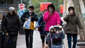 2118 muertos por coronavirus en China; baja nuevos infectados