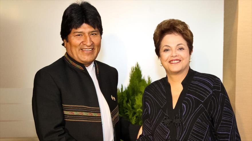Los entonces presidentes de Brasil y Bolivia, Dilma Rousseff y Evo Morales, respectivamente, en una foto tomada en Venezuela el 2 de diciembre de 2011.