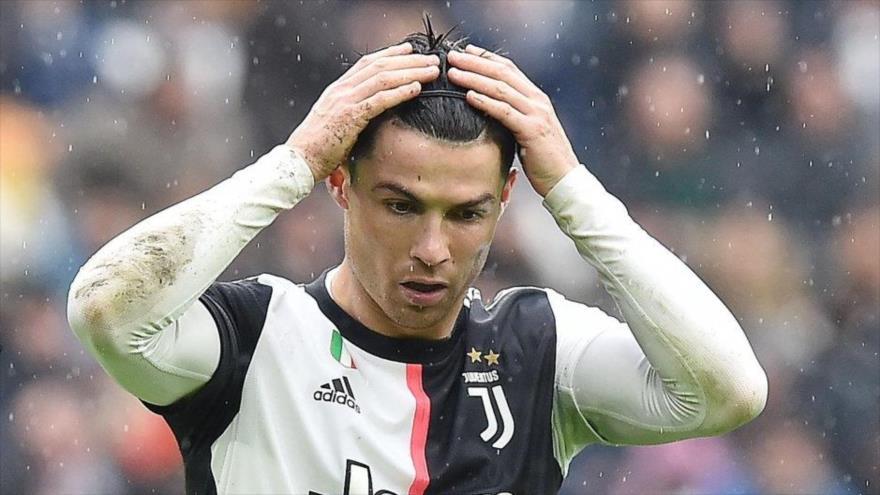 El delantero portugués Cristiano Ronaldo lamentando la derrota de la Juventus (Foto: EFE).
