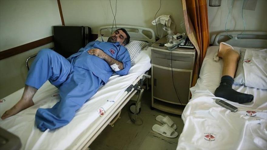 Veterano iraní de la guerra impuesta por Irak, víctima de armas químicas, en un hospital en Teherán, capital de Irán. (Foto: Tasnim)