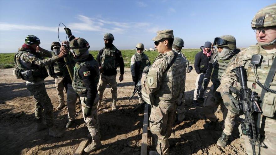 Tropas de la 'coalición' anti-EIIL de Estados Unidos en la base de Basmaya, Bagdad, capital de Irak.