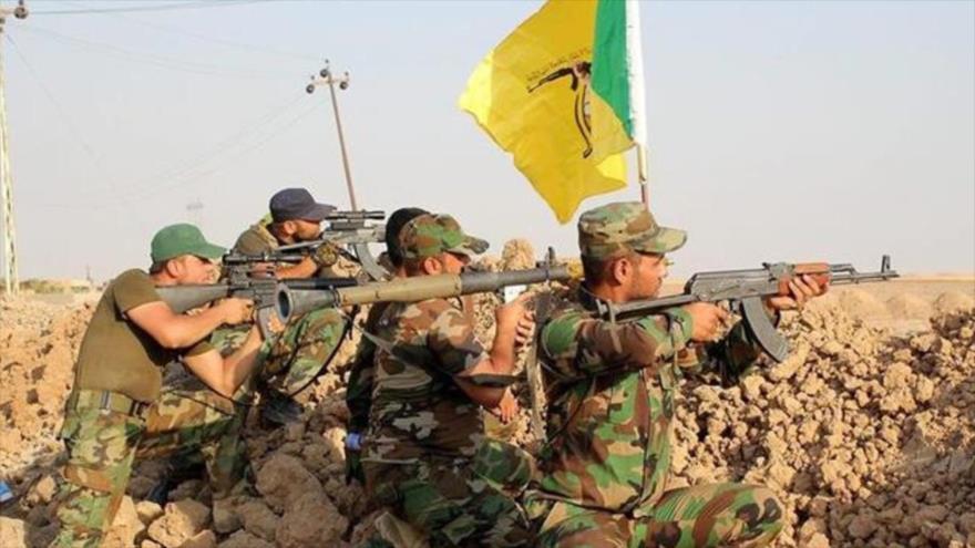 Miembros del Movimiento de Resistencia Islámica de Irak, conocido como Kataeb Hezbolá.