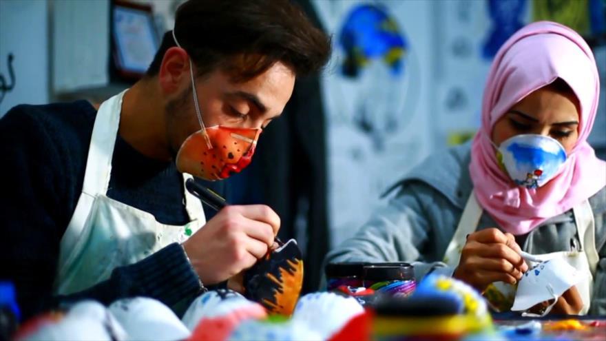 Palestinos en Gaza hacen frente a COVID-19 de una forma artística | HISPANTV
