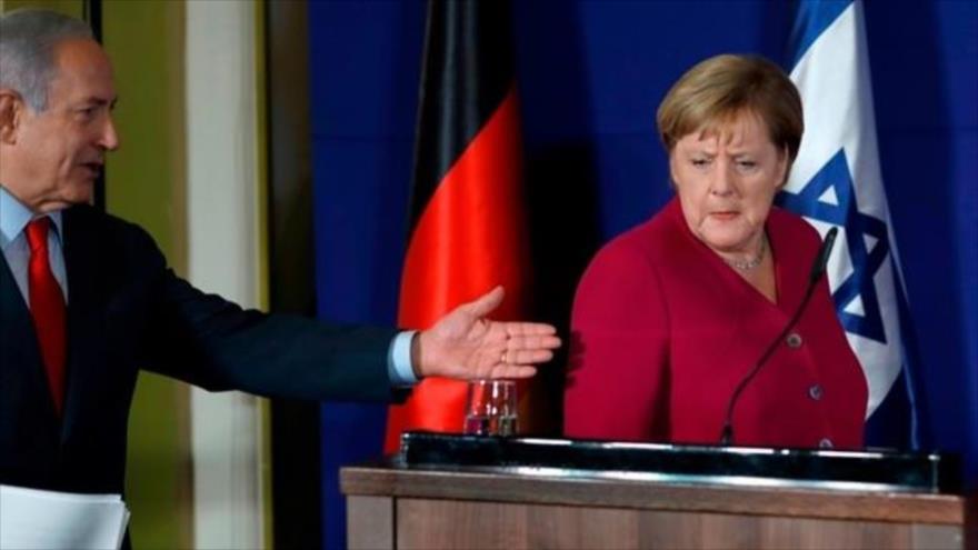 Primer ministro israelí, Benjamín Netanyahu, y la canciller alemana, Angela Merkel, durante una rueda de prensa en Al-Quds, 4 de octubre de 2018.
