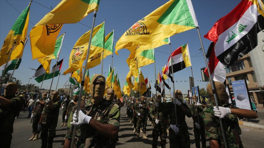 Combatientes del Movimiento de Resistencia Islámica de Irak (Kataib Hezbolá), durante un desfile militar en Bagdad (capital), 31 de mayo de 2019. (Foto: AFP)