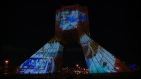 Torre Azadi de Teherán se ilumina en solidaridad contra COVID-19