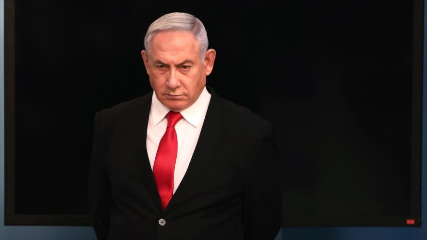 Premier israelí, Benjamín Netanyahu, llega para hablar en su oficina de Jerusalén sobre nuevo coronavirus en Israel, 14 de marzo de 2020. (Foto: AFP)