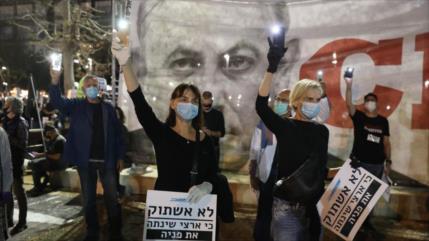 Miles de israelíes marchan contra Netanyahu, acusado de corrupción