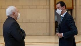 Zarif se reúne con Al-Asad para reforzar lazos Irán-Siria