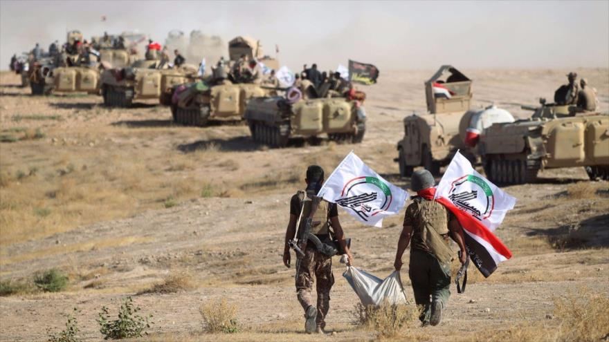Combatientes de las Unidades de la Movilización Popular (Al-Hashad Al-Shabi, en árabe) de Irak, que forman parte de las Fuerzas Armadas del país.