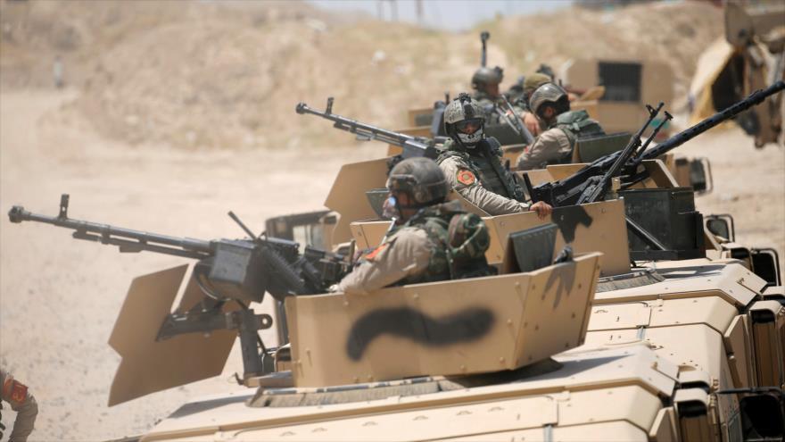 Fuerzas de seguridad iraquíes en las afueras de Faluya, al oeste de Bagdad, la capital. (Foto: Reuters)