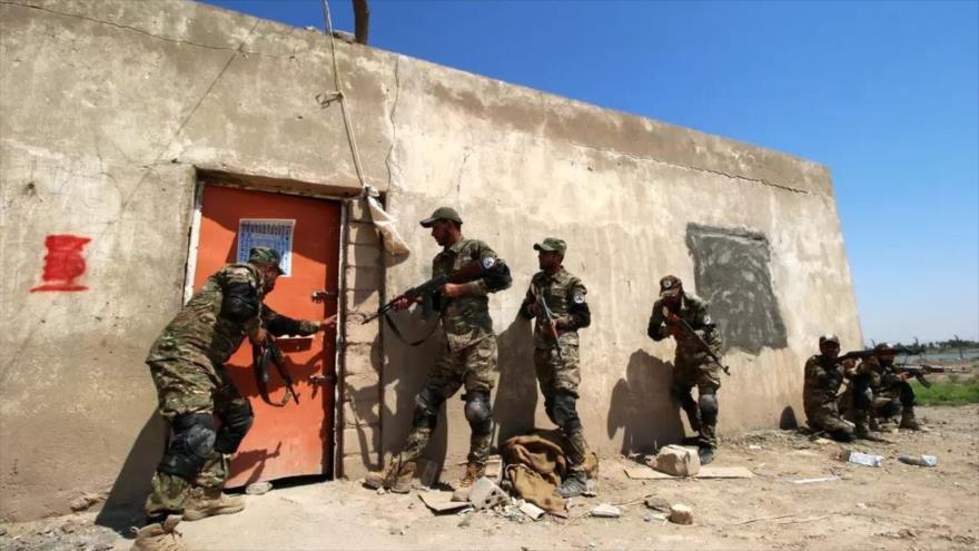 Los combatientes de Al-Hashad Al-Shabi en una operación antiterrorista cerca de la frontera con Siria.