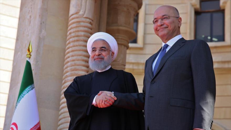 El presidente de Irán, Hasan Rohani (izq.) y su homólogo iraquí, Barham Salih, en Bagdad, capital de Irak, 11 de marzo de 2019.