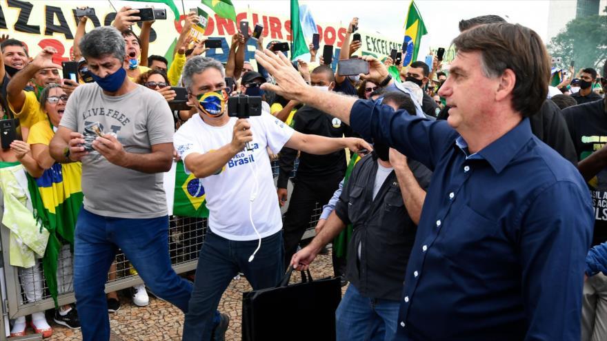 El mandatario de Brasil, Jair Bolsonaro, en una manifestación en Brasilia, 24 de mayo de 2020. (Foto: AFP)