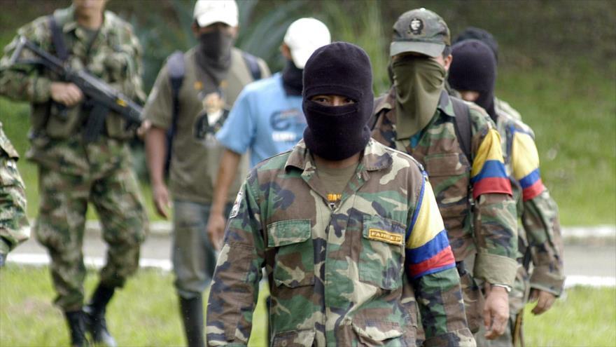 Combatientes de la antigua Fuerzas Armadas Revolucionarias de Colombia (FARC).