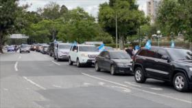 Guatemaltecos informes manifiestan en Vehículos su descontento
