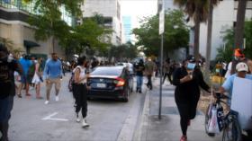 Prensa, manifestantes, gente y la puntería de la policía en EEUU
