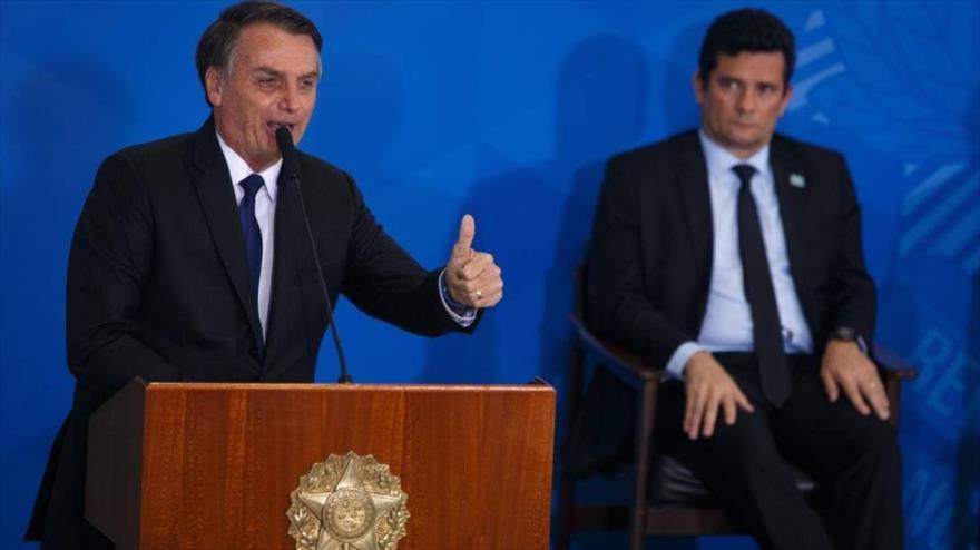 El presidente brasileño, Jair Bolsonaro, junto a su entonces ministro de Justicia, Sergio Moro.