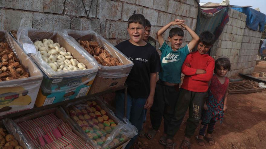 Niños sirios en el norte de la provincia de Idlib, en el noroeste de Siria, 22 de mayo de 2020. (Foto: AFP)