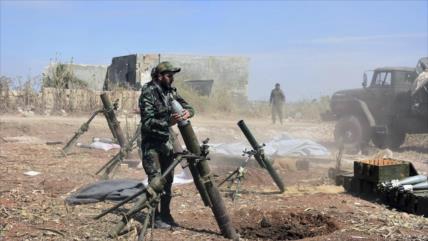Siria, con escolta aérea de drones rusos, ataca a terroristas